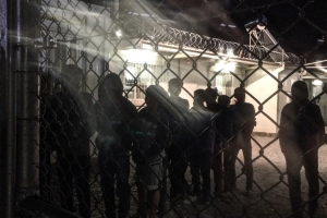 Unaccompanied children line up for an evening meal at a detention facility run by the Greek police. © 2015 Kelly Lynn Lunde